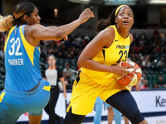 Indiana Fever forward Stephanie Mavunga (23) drives around Chicago Sky forward Cheyenne Parker (32) in the first half of their WNBA preseason basketball game at Bankers Life Fieldhouse on Monday, May 7, 2018.