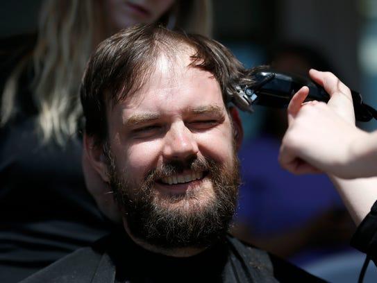 SPS teacher Matthew Bills, as his head shaved on Saturday,
