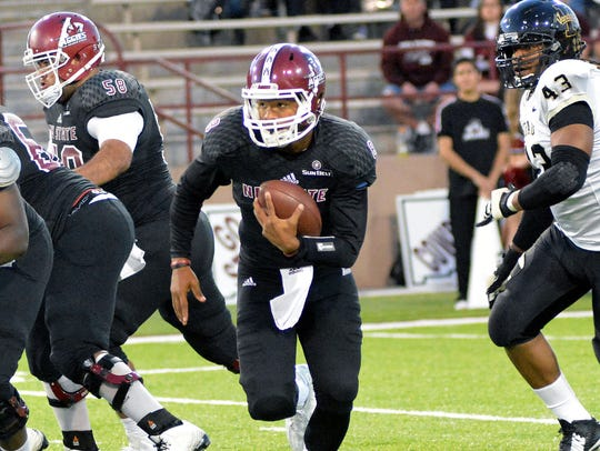 New Mexico State quarterback Andrew Allen runs for