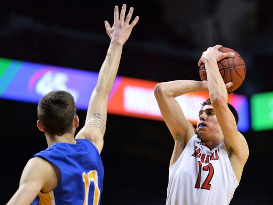 Annandale's Brad Weege (12) protects the ball from