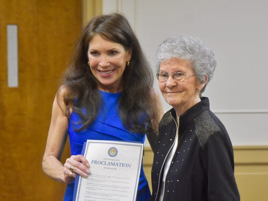 Longtime Gallatin City Councilwoman Anne Kemp, right,