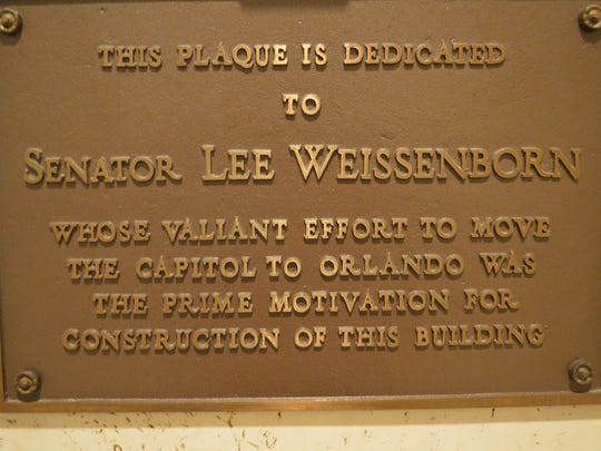 This plaque, on the first floor of the 22-story Florida capitol, pays tribute to the late Florida Senator Lee Weissenborn, whose 1967 proposal to move the capital galvanized Tallahassee.