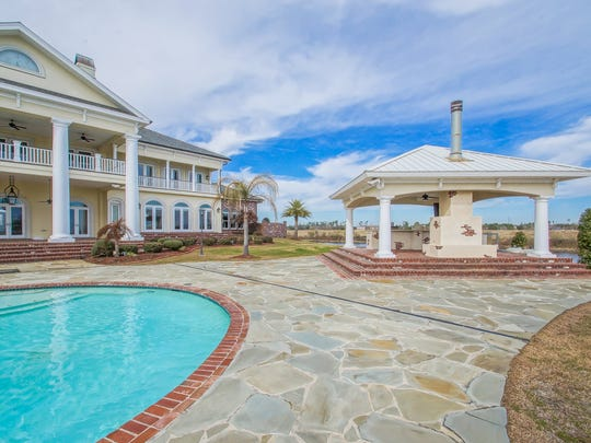 This six-bedroom, seven-bath home is located at 238