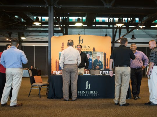 People gather around the Flint Hills booth during the USO of South Texas Hiring our Heroes job fair at the Congressman Solomon P. Ortiz International Center on Tuesday, June 13, 2017.