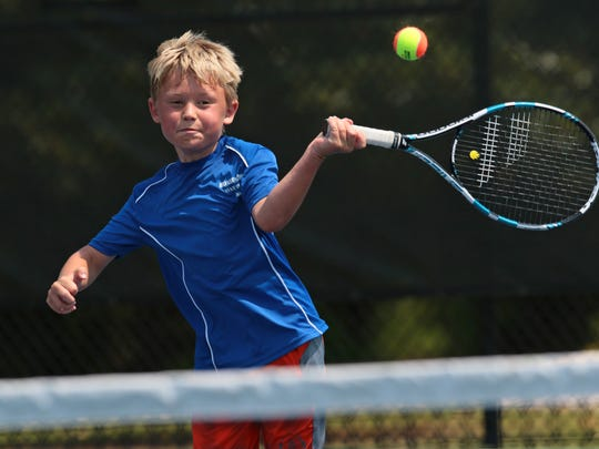 Noah Johnston returns a ball to Hayden Darby in the Boys 10U singles at Leda Poore Park in Belton. Johnston, the son of Sophie Woorons, won 4-1, 4-1.