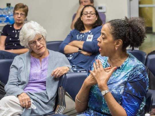 Members of the the community listen to a panel discussing President Donald Trump and the National Football League hosted by the Democratic Women of the Desert at the James O. Jessie center in Palm Springs on November 14, 2017.