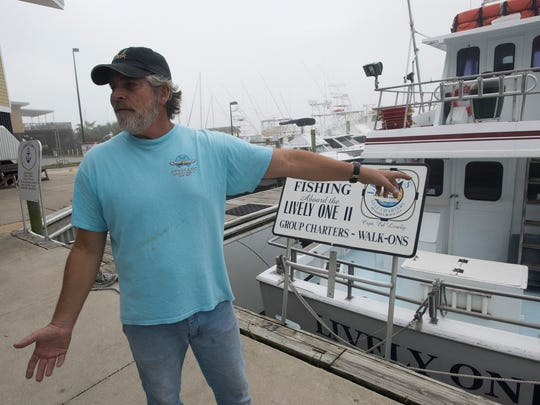 Kurt Schnupp, dock manager at the Pensacola Beach Marina, talks Tuesday, Dec. 19, 2017, about how over regulation has hampered the sports fishing industry.