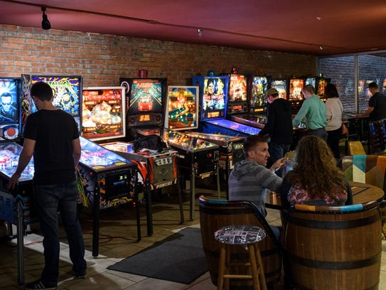 People play pinball and other arcade games while hanging out at High Score Saloon in downtown Evansville. The arcade opened in December and is open from 5 p.m. to midnight Monday through Thursday; 5 p.m. to 1 a.m. Friday; 1 p.m. to 1 a.m. Saturday and 2 p.m. to midnight Sunday.
