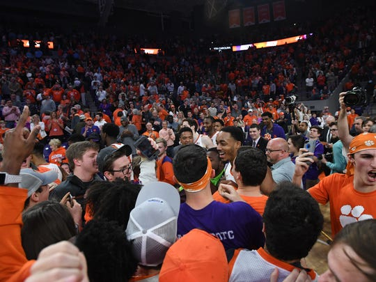 Clemson fans storm the court after the Tiger's 82-78