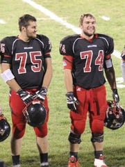 Cole Banwart (75) smiles at his friend and fellow lineman