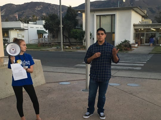 Isaiah Ruiz, 18, a senior at Santa Paula High, participates in a rally before Monday night's City Council meeting in Santa Paula. Ruiz is part of CAUSE's Santa Paula chapter.