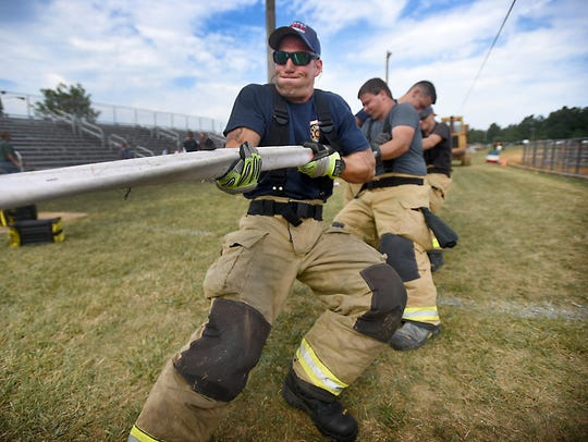 Hershey firefighters participate in the Hose Tug-of-War