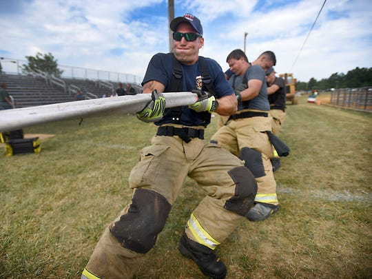 Hershey firefighters participate in the Hose Tug-of-War during the 2016 Lebanon Area Fair Annual Fire Competition Sunday, July 24.