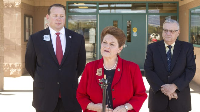 Arizona Sen. Brenda Barton talks to the press as Arizona Senator Jeff Dial (left) and Maricopa County Sheriff Joe Arpaio listen, at Horseshoe Trails Elementary School in Phoenix on Friday, February 13, 2015. A new bill sponsored by Arizona Senators Dial and Barton would restore state funding for full-day kindergarten. Arpaio is in favor of the bill because he feels it will reduce crime.