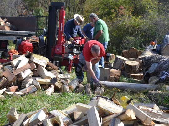 Volunteers bring their own equipment to cut and split wood on behalf of Swannanoa Valley Christian Ministry