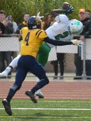 Novi Wildcat Traveon Maddox, Jr., hauls in this pass for a touchdown in South Lyon's north endzone as Danique Lewis provides coverage.