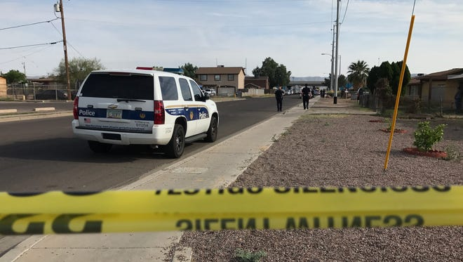 Phoenix Police investigate an officer-involved shooting on 15th Avenue on April 9, 2017. Police said a man reached for an officer's holstered weapon and was able to fire off a shot..