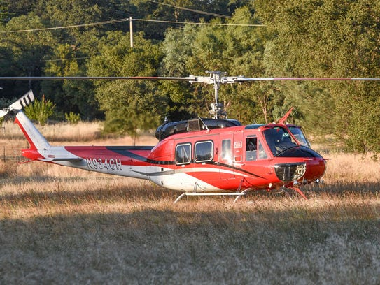A helicopter under contract to Cal Fire prepares to