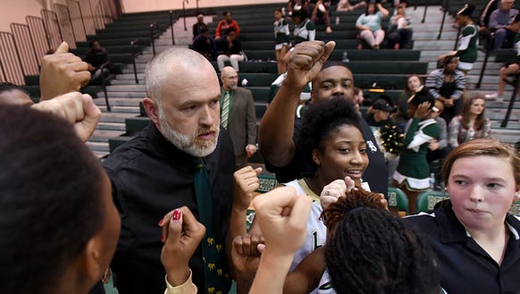 Berea girls basketball coach Matt Lindsey celebrates with his team after the Bulldogs defeated Chester 68-23 in the first round of the Class AAA playoffs Monday at Berea High School.