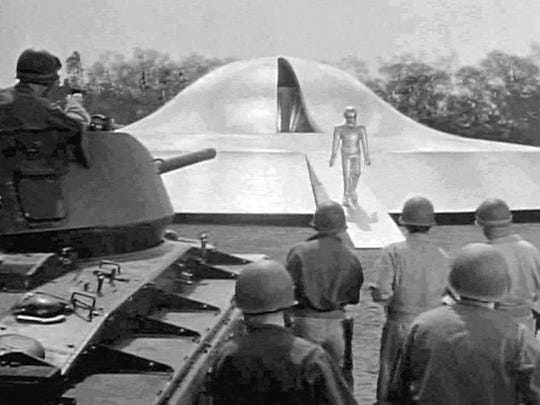 Soldiers surround a landed flying saucer in 1951's