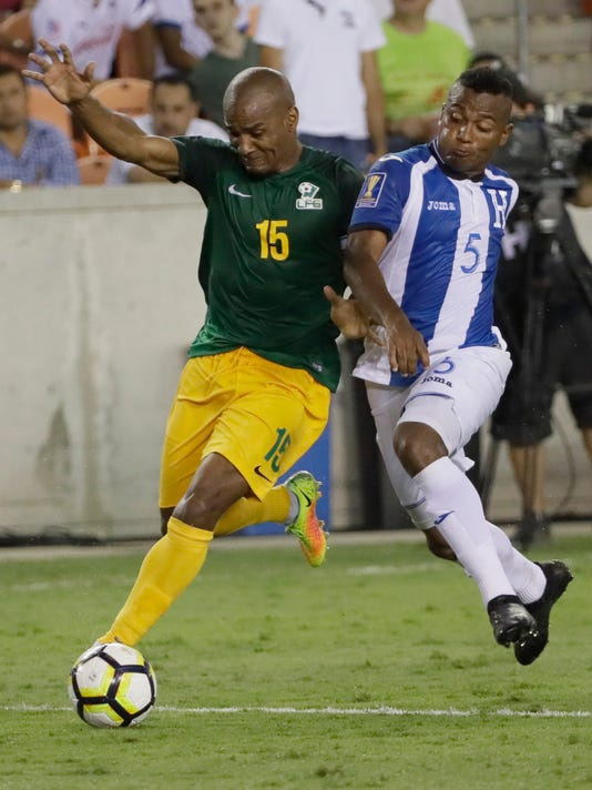 French Guiana midfielder Florent Malouda (15) controls the as Honduras defenseman Ever Alvarado (5) challenges him during a CONCACAF Gold Cup soccer match Tuesday, July 11, 2017, in Houston. The match ended in 0-0 tie. (AP Photo/David J. Phillip)