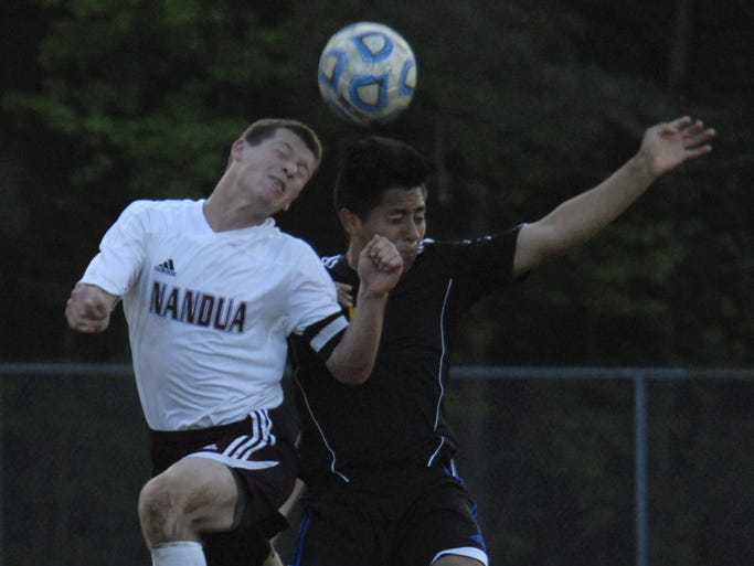 Nandua's David Wright, left, and Northampton's Sammy Pineda go for a header during the second half of a game in Onley Monday, May 12, 2014. The Warriors won, 6-0.
