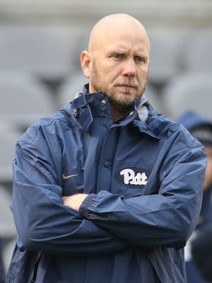 Pittsburgh Panthers offensive coordinator Matt Canada looks on during warm-ups before the Panthers host the Syracuse Orange.