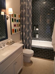 One of the bathrooms in the HGTV Smart Home was tiled in a gorgeous navy blue subway tile.