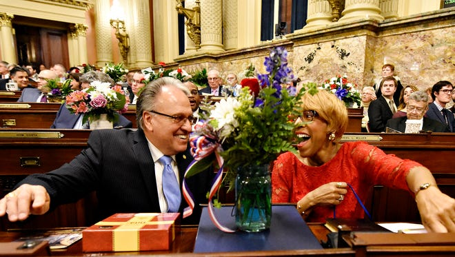 Rep. Eddie Day Pashinski, D-Luzerne, left, shows Rep. Carol Hill-Evans, D-York City, where to find her button during the swearing-in ceremony at the Capitol in Harrisburg, Tuesday, Jan. 3, 2017. Dawn J. Sagert photo