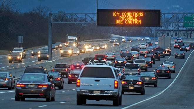 A traffic sign on Interstate 65 northbound warns of icy road conditions as traffic slowly moves in Brentwood, Tenn., Wednesday, Jan. 14, 2015.