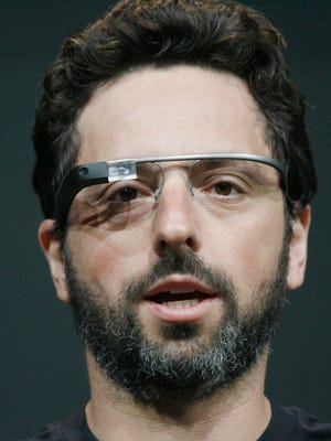 Sergey Brin, co-founder of Google, appears at the keynote with the Google Glass to introduce the Google Class Explorer edition during Google's annual developer conference on June 27, 2012.