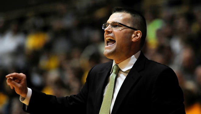 Green Bay coach Brian Wardle reacts to a play in the second half of an NCAA college basketball game against Valparaiso in the championship of the Horizon League conference tournament Tuesday, March 10, 2015, in Valparaiso, Ind. (AP Photo/Joe Raymond)