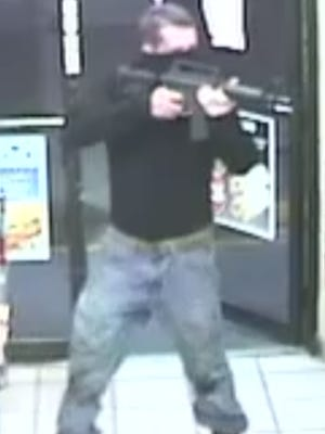 A robber wielding an AR style rifle made off with cash from a North Fort Myers convenience story Sunday night.