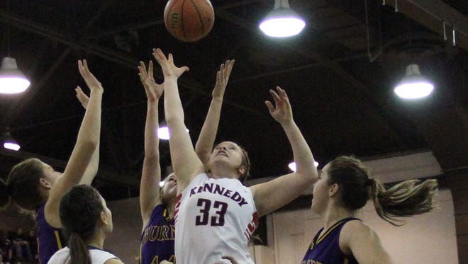 Kennedy's Kenzie Ratliff (33) goes up with a shot in traffic against Burns in an OSAA Class 2A state semifinal game last year.