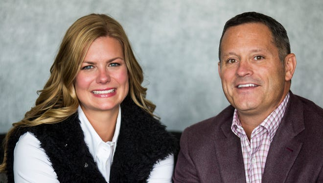 Chris Cicchinelli, CEO & owner of Pure Romance, and his wife, Jessica Cicchinelli, pose for a portrait at the Pure Romance Headquarters in downtown Cincinnati Thursday, January 25, 2018. They have created the Living with Change: The LC Foundation, which will train teachers and other educators and provide financial support to the Adolescent and Transition Medicine Clinic at Cincinnati Children's Hospital Medical Center. The foundation is named after their transgender daughter, LC.