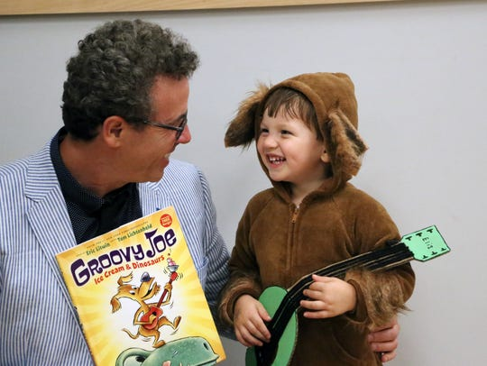 Best-selling children's author and musician Eric Litwin greets fans and signs autographs after his show in Greenville in September.