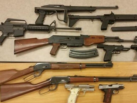 Guns were seized at the home of Osvaldo Perez.