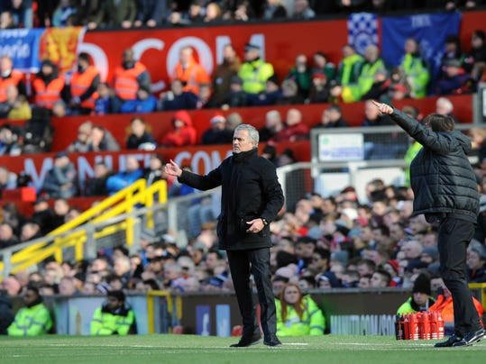 Manchester United coach Jose Mourinho, left, and Chelsea's team manager Antonio Conte give directions during the English Premier League soccer match between Manchester United and Chelsea at the Old Trafford stadium in Manchester, England, Sunday, Feb. 25, 2018. (AP Photo/Rui Vieira)