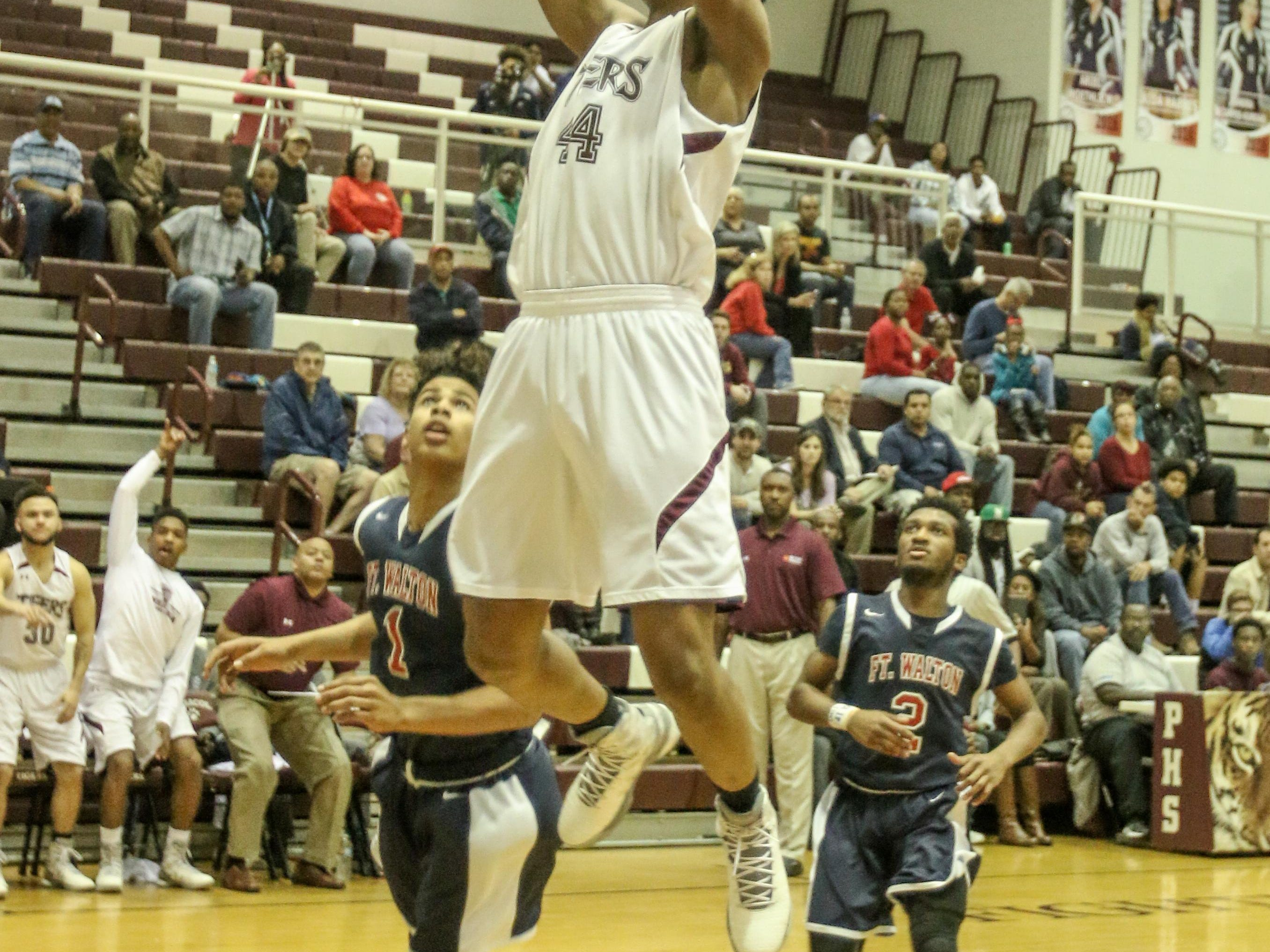 Pensacola High's Davonchae Bryant slams down a dunk during the District 1-6A quarterfinal playoff game Thursday night at Pensacola High School.