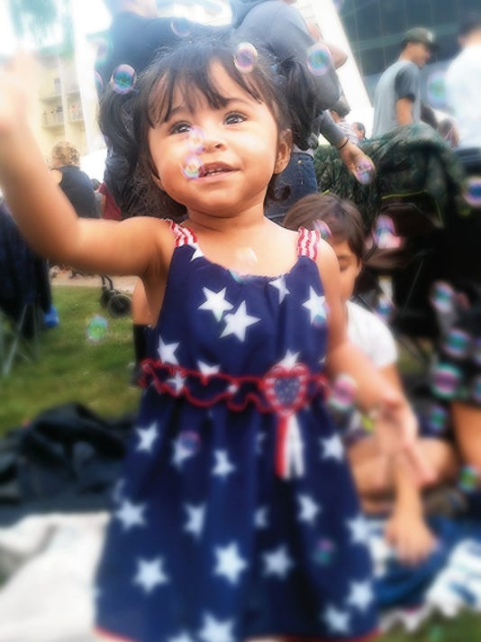 Hailey, a 1-year-old visitor from El Paso, was all stars, stripes and bubbles at the Inn of the Mountain Gods July 4th celebration.