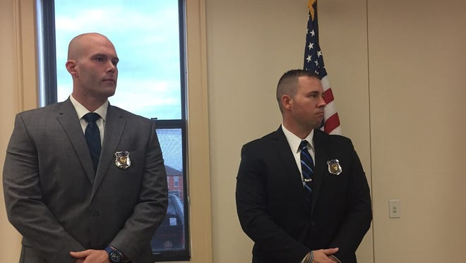 Benjamin Sholl, left, and Alex Colles, right, were sworn in as Newark Police Officers on Monday.