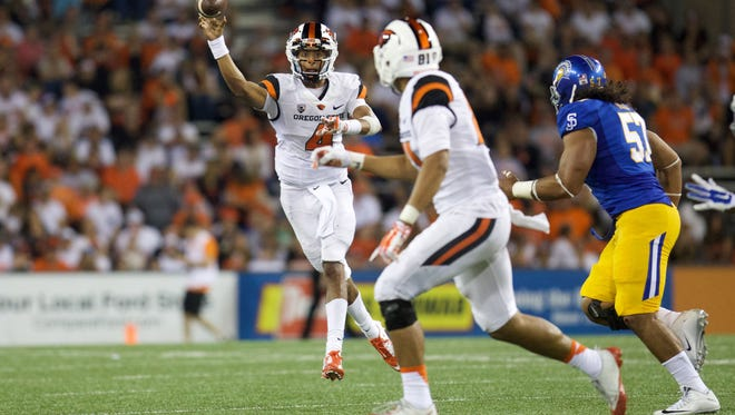 Sep 19, 2015; Corvallis, OR, USA; Oregon State Beavers quarterback Seth Collins (4) throws the ball to Oregon State Beavers tight end Noah Togiai (81) as San Jose State Spartans defensive tackle Nate Falo (57) defends at Reser Stadium. Mandatory Credit: Scott Olmos-USA TODAY Sports