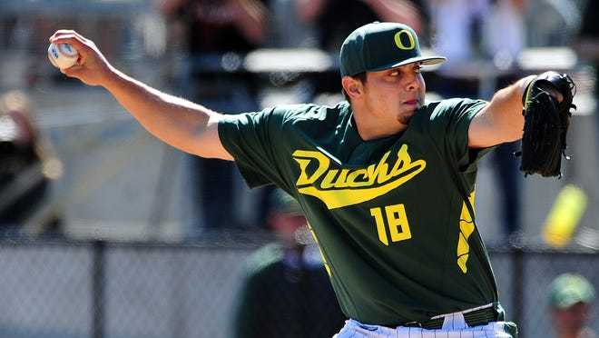 Oregon pitcher Josh Graham throws against Oregon State at PK Park, on Sunday, April 12, 2015, in Eugene. Oregon won the game 10-9.