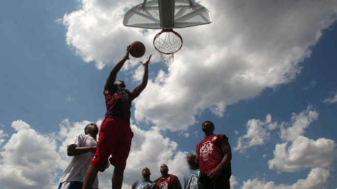 Jason Rogers of Piscataway grabs a rebound during the annual Week of the People basketball tournament in Somerset.