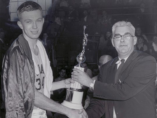 Don Schulndt, left, received congratulations from his coach, Branch McCracken March 17, 1953 at Chicago after he scored 41 points to lead the Hoosiers to victory over Notre Dame in the NCAA tournament.