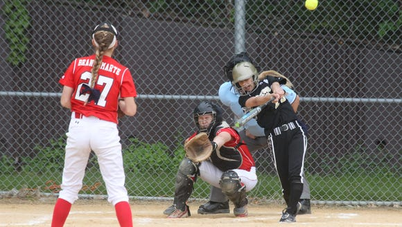 Clarkstown South's Lindsey Hoag gets a hit during a