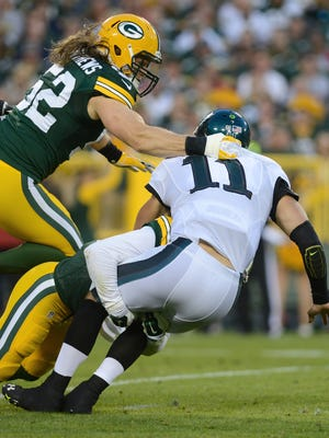 Green Bay Packers outside linebacker Clay Matthews (52) gets a hand on Philadelphia Eagles quarterback Tim Tebow (11) in the first quarter. The Green Bay Packers hosted the Philadelphia Eagles in a preseason game at Lambeau Field in Green Bay, Wis. on Saturday, Aug. 29, 2015. Kyle Bursaw/Press-Gazette Media/@kbursaw
