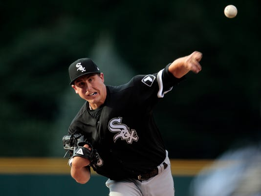 Chicago White Sox starting pitcher Derek Holland (45) pitches to the Colorado Rockies during the first inning of a baseball game Friday, July 7, 2017, in Denver. (AP Photo/Joe Mahoney)