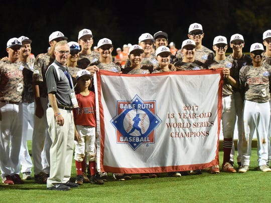 Tri Valley, Calif., takes a team photo after winning the Babe Ruth 13-year-old World Series on Thursday at McClain Park.