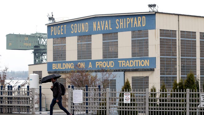 The Puget Sound Naval Shipyard is in the background at the Bremerton ferry terminal on Wednesday.